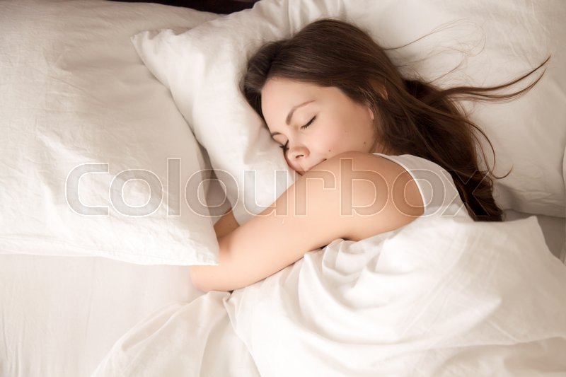 Top View Of Attractive Young Woman Sleeping Well In Bed