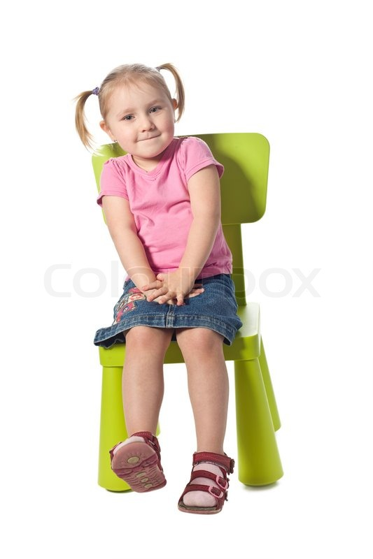 The Little Child Sits On A Chair Stock Image Colourbox