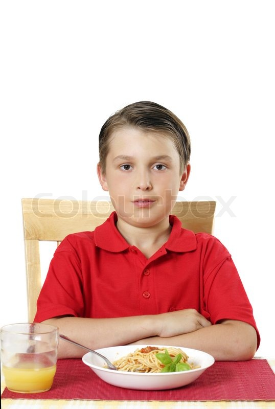 Child sitting at table ready to eat some delicious food for Eating table