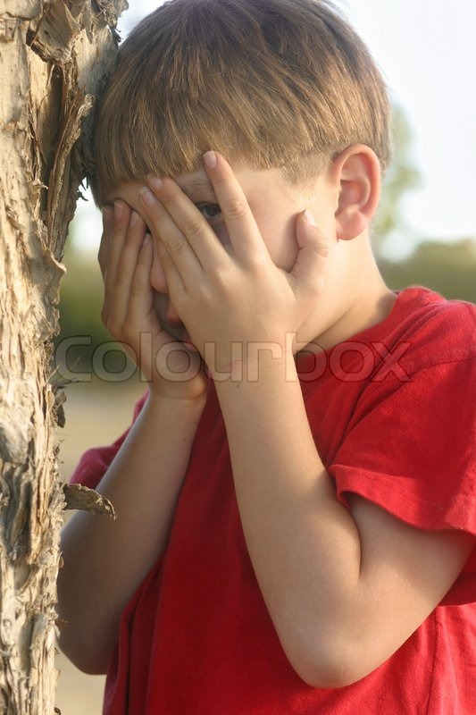Stock image of 'Boy playing hide and seek'