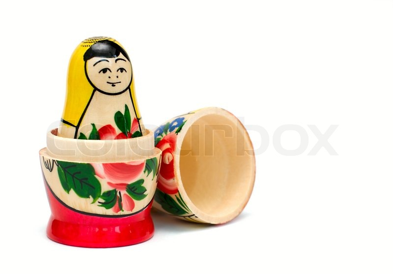 Russian wooden toy in the form of a painted doll, inside ...