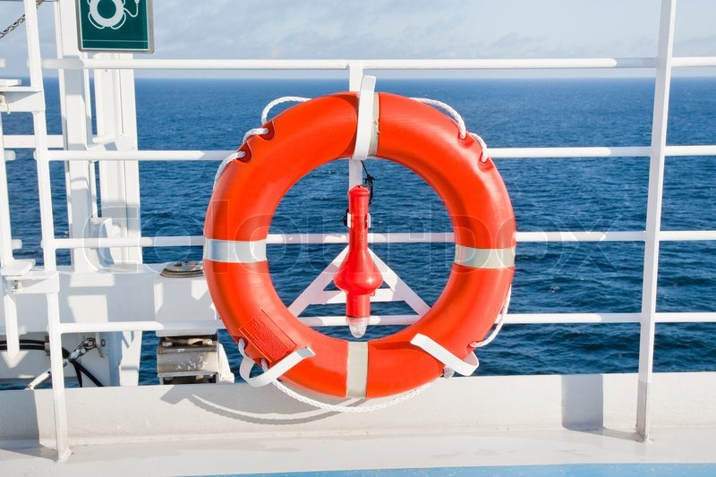 Red Life Buoy On Side Of Sea Cruise Liner Stock Photo