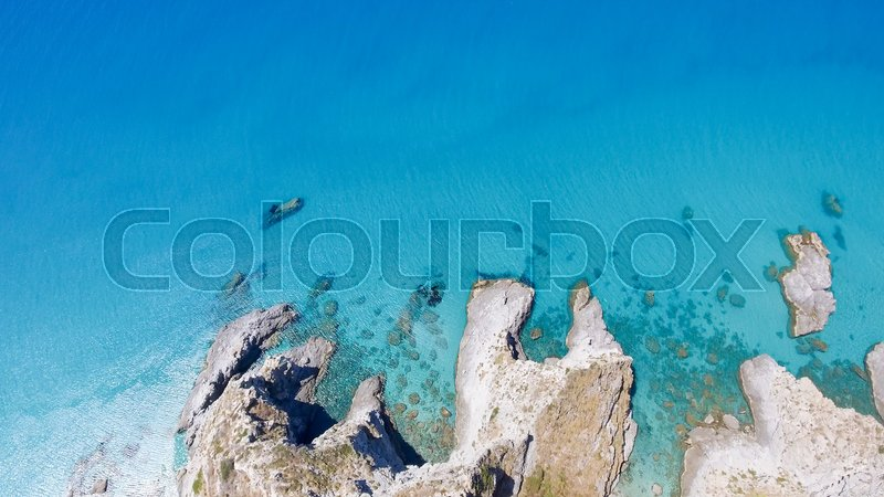 Overhead view of beautiful rocks over crystal clear ocean, stock photo