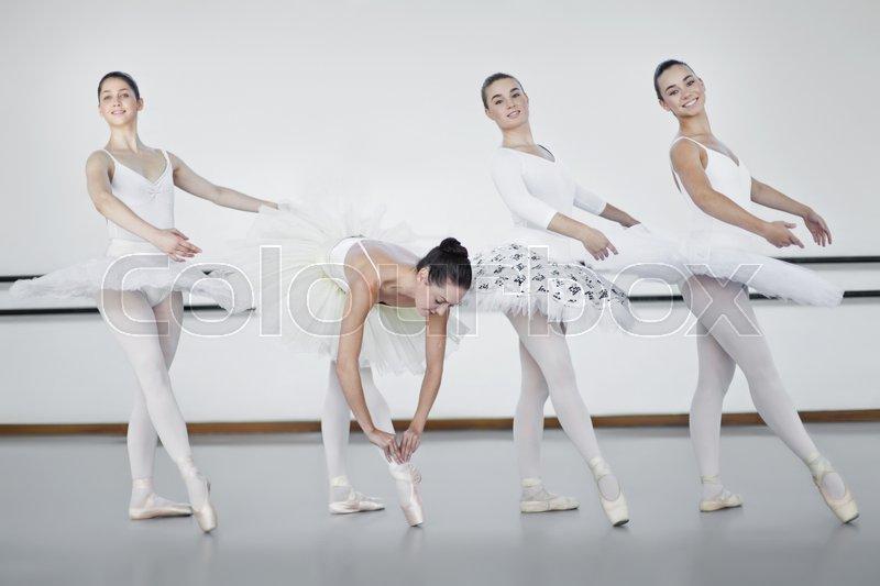 Ballet dancers standing in studio, stock photo