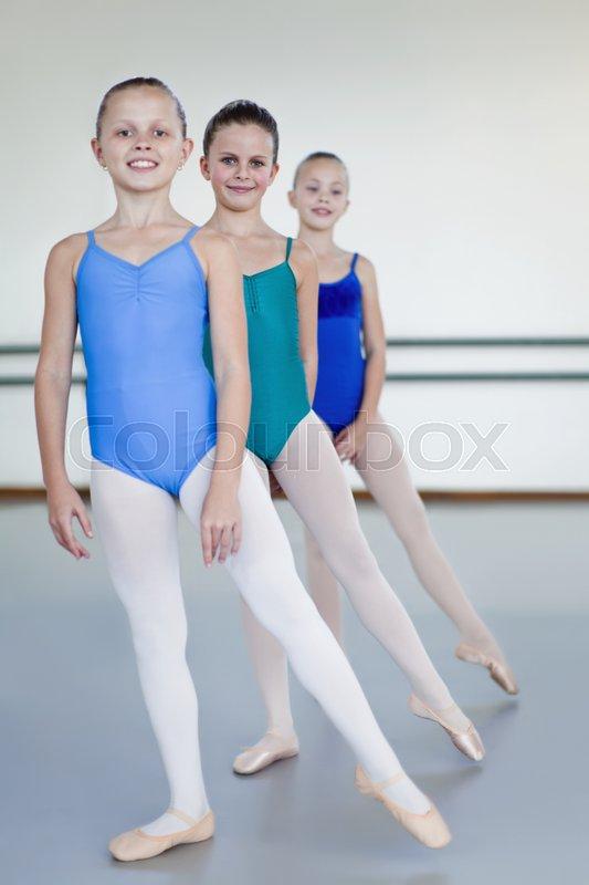Ballet dancers posing in studio, stock photo