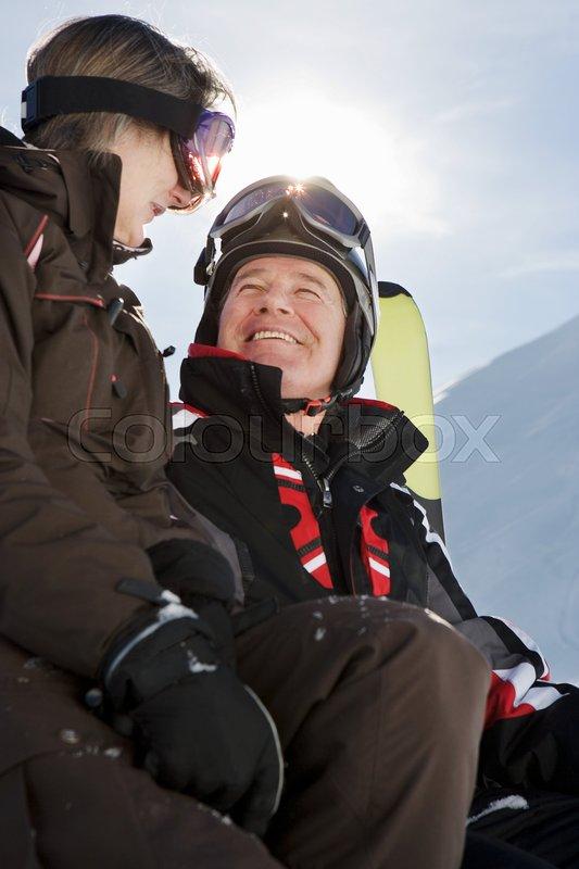 Mature couple in ski-wear, stock photo