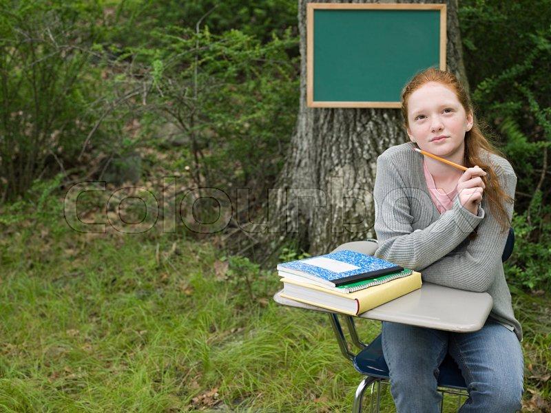 A girl thinking, stock photo