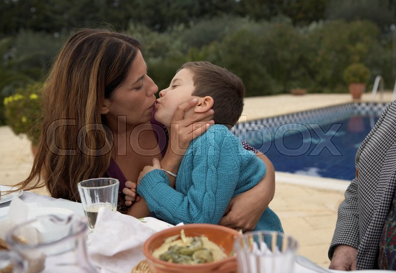 Mother Kissing Son At The Table  Stock Image  Colourbox-6845