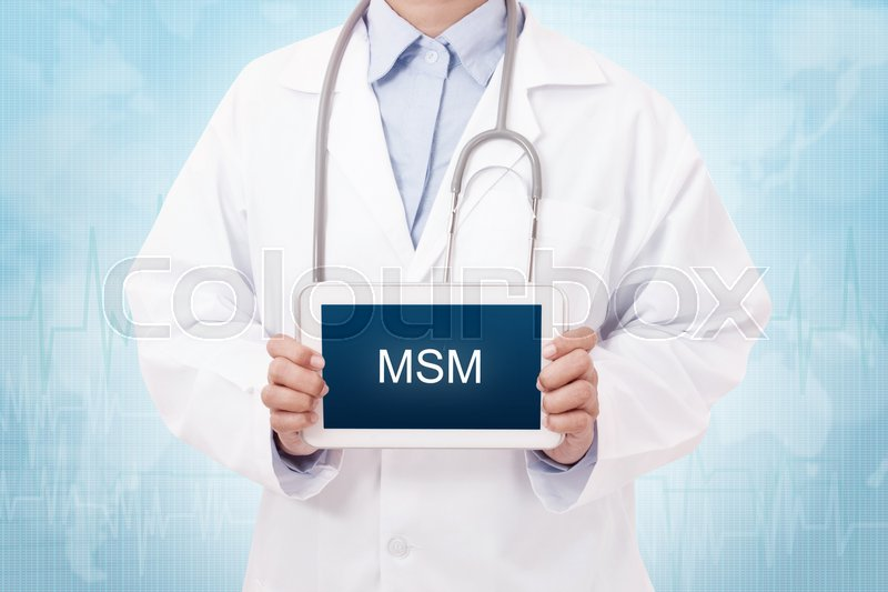 Doctor holding a tablet pc with MSM       Stock image   Colourbox