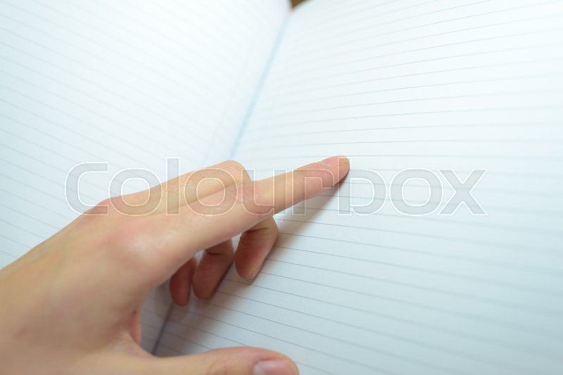 Notebook are hand pointing out line, stock photo