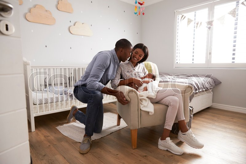 Parents Home from Hospital With Newborn Baby In Nursery, stock photo