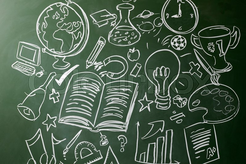 Hand drawn symbols of school subjects on a chalkboard, stock photo