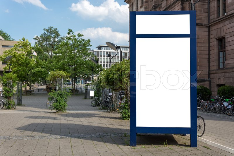 A blue blank ad space sign isolated in the street, stock photo