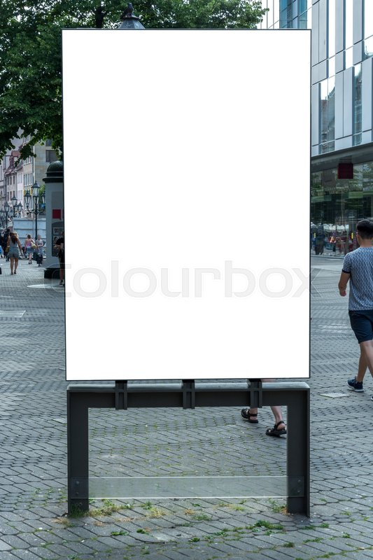 A blank ad space sign isolated in the street, stock photo