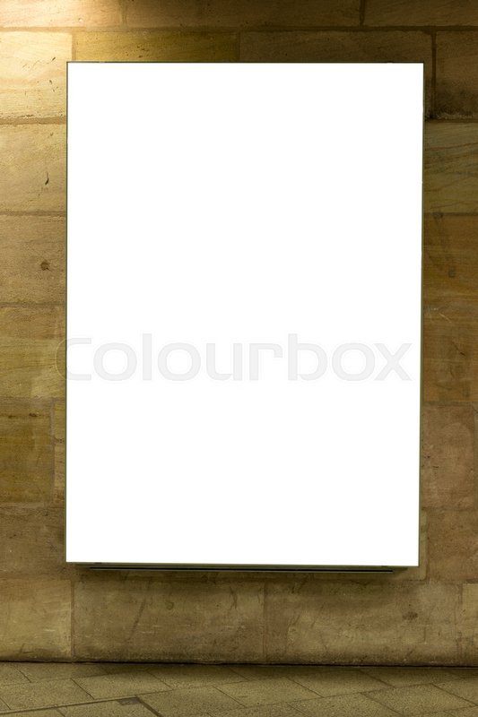Blank ad space sign isolated on a brick wall in the subway, stock photo