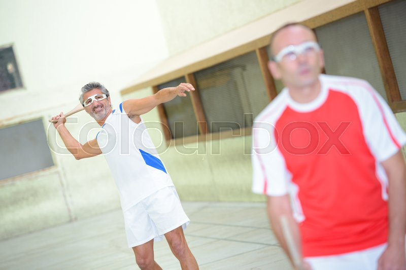 Active men on sports court, stock photo