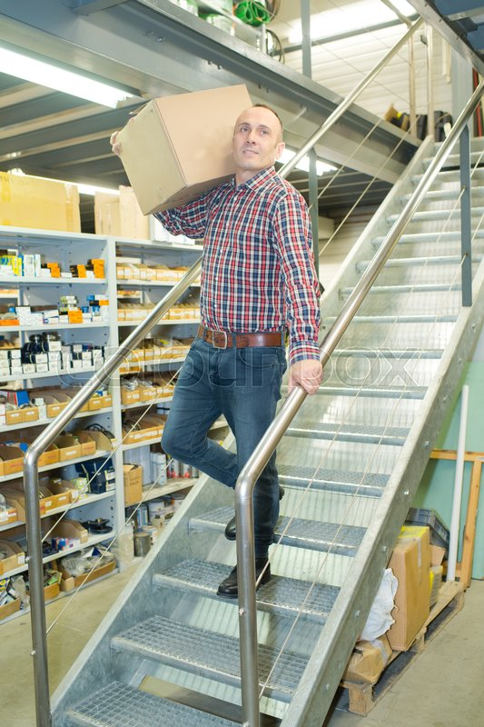 Man Working On The Stairs In The Warehouse, Stock Photo