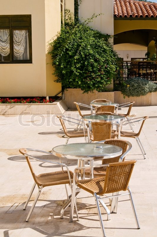 Modern cafe furniture on the resort by summer stock