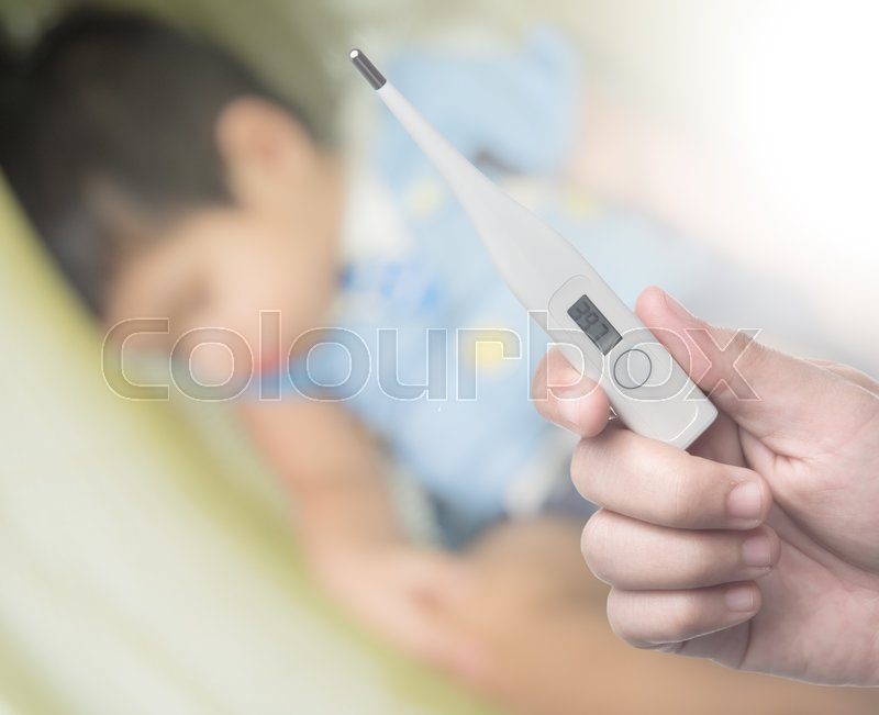 Holding electronic thermometer on background of sick children, stock photo