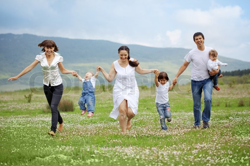 2722725-626270-group-of-happy-parents-with-children-running-in-field