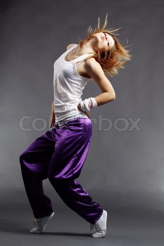 Teenage girl dancing hip-hop studio series, stock photo