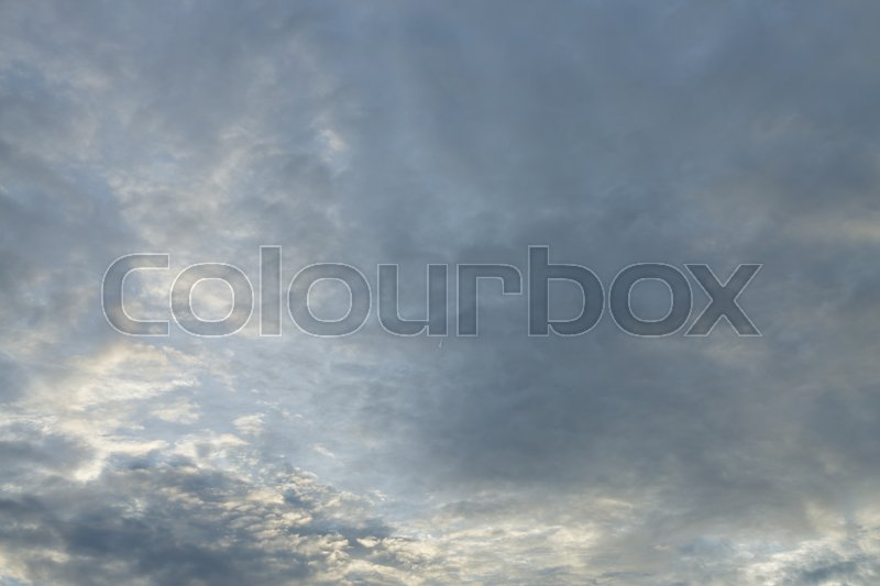 Monsoon weather dramatic moody rain storm sky with light in the darkness cloudy, stock photo