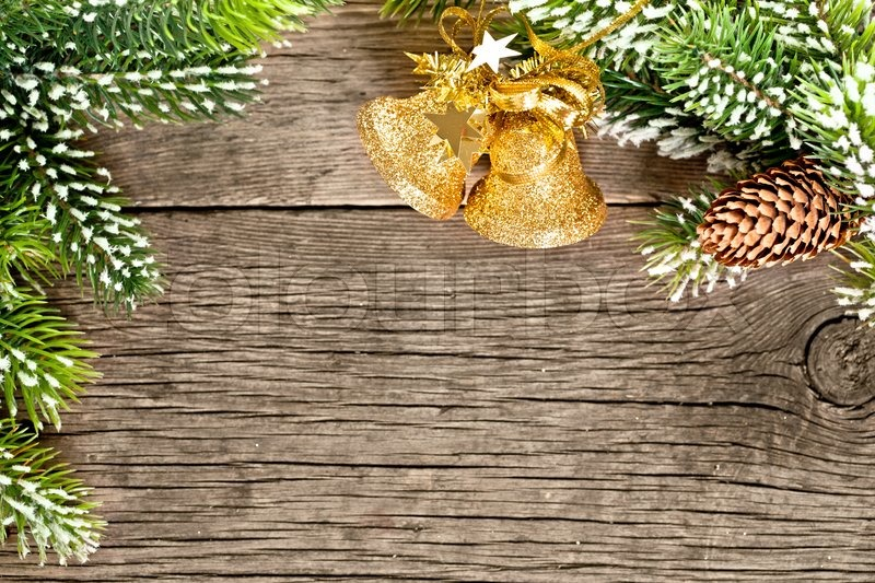 christmas frame from branch and decorations on old wooden