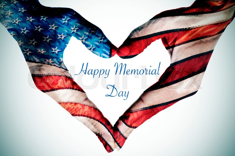The text happy memorial day written in the blank space of a heart sign made with the hands of a woman patterned as the flag of the United States, stock photo