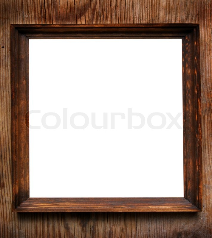 Empty square frame close-up over wooden wall | Stock Photo | Colourbox