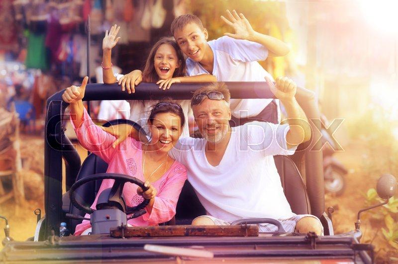Portrait of big happy family in car, stock photo
