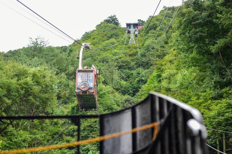 KAWAGUCHIKO, JAPAN - OCTOBER 09, 2016: Cable car on ropeway going up and to mountain in lake Kawaguchiko in Yamanashi province Japan during autumn, stock photo
