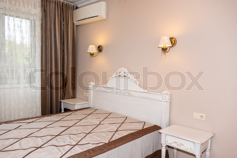 Stock image of 'Small modern bedroom interior. Pastel colors, interior design.'