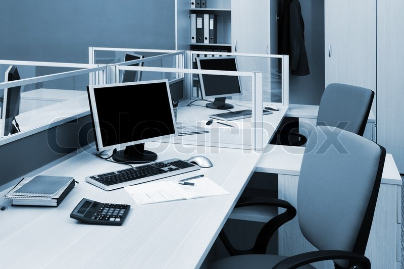 computers on a desk in a modern office stock photo colourbox. Black Bedroom Furniture Sets. Home Design Ideas