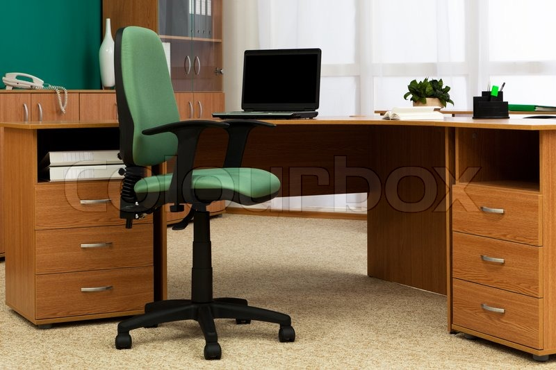 New laptop on a desk at modern office | Stock Photo | Colourbox