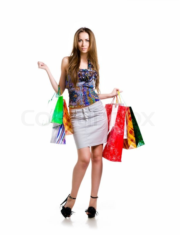 Lastest Casual Woman Walking With Shopping Bags Isolated Over A White