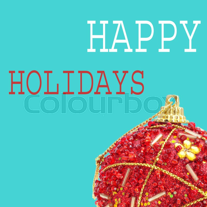 An ornamented red christmas ball and the text happy holidays on a blue background, in a pop art style, stock photo