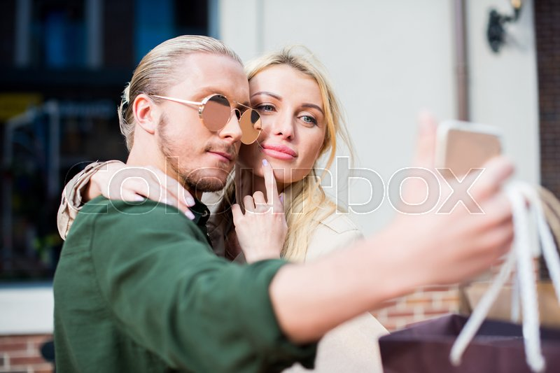 Young Stylish Couple Posing Together While Taking Selfie On Smartphone
