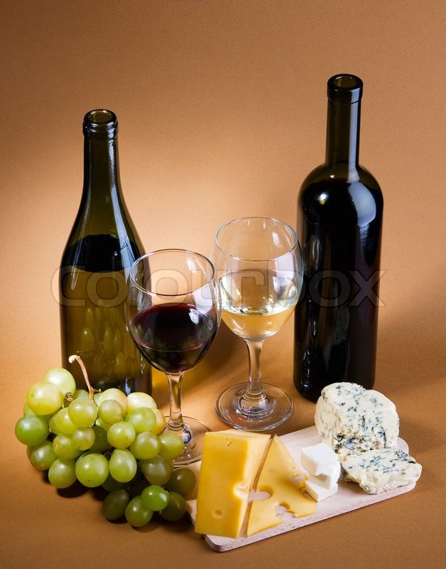 Wine Grapes And Differentkinds Of Cheese Still Life