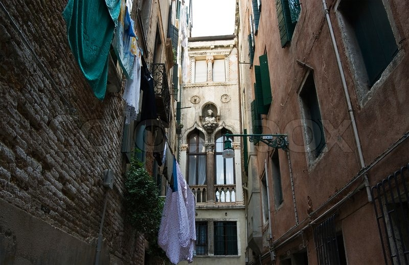 One Of Narrow Small Streets In Venice Stock Photo