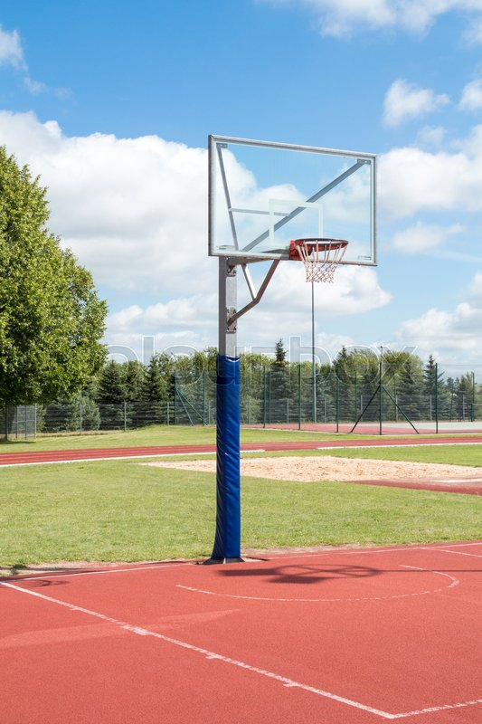Public outdoor basketball court in a park, stock photo