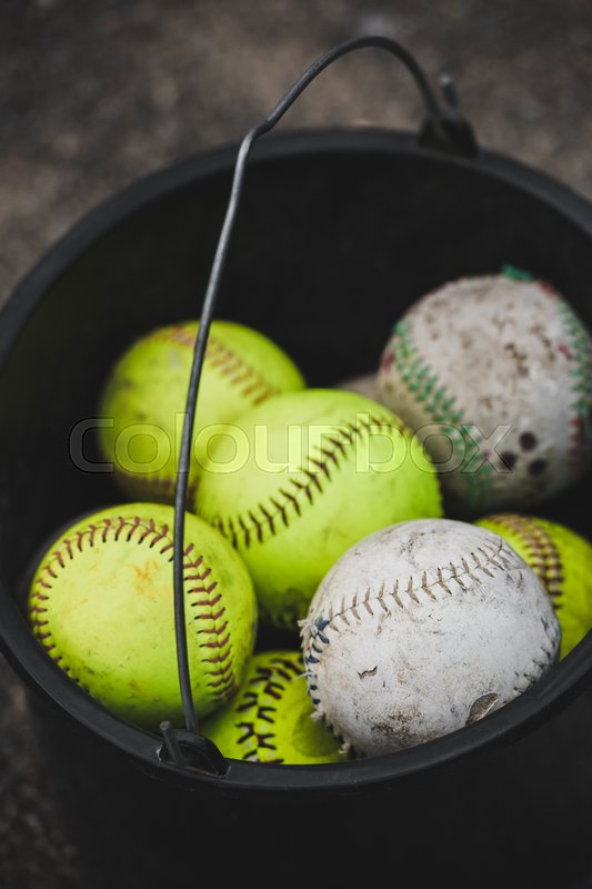 Close-up above view of bucket full of baseball balls, stock photo
