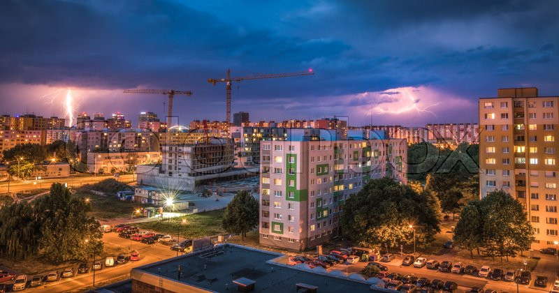 Lightnings Over Housing Estate. Night Storm in the City, stock photo
