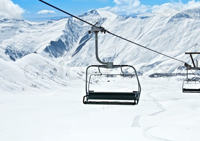 Delightful Ski Lift Chairs On Bright Winter Day, Stock Photo