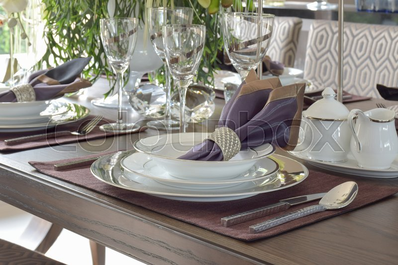 Classic elegance style dining set on wooden dining table, stock photo