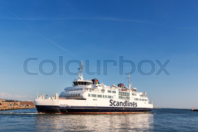 Editorial image of 'Scandlines ferry leaving harbour. Scandlines is a ferry company transporting passengers, trucks, cars and trains etc. between Denmark -Sweden / Germany.'