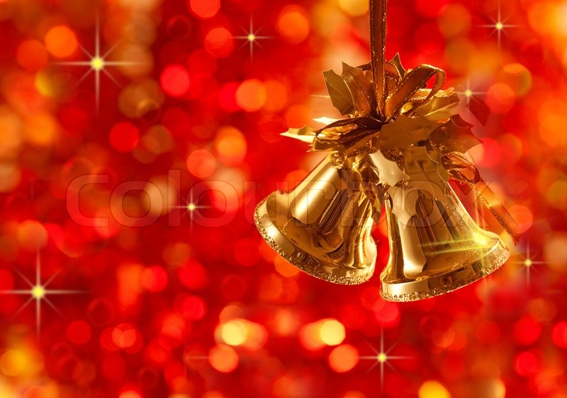Gold Christmas tree decorations on lights background | Stock Photo ...