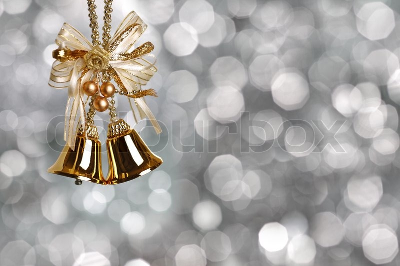 Gold Christmas bells on silver blurred background | Stock ...