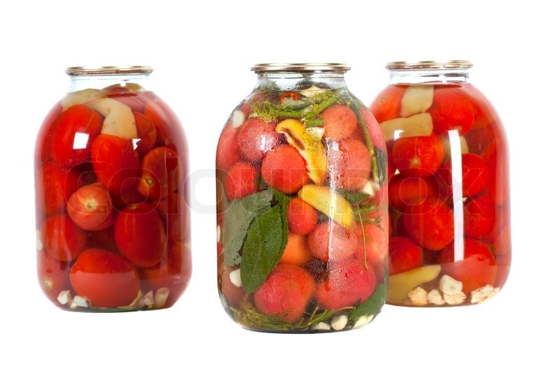Stock image of 'Preserved red tomatoes in a glass jar isolated on white background'