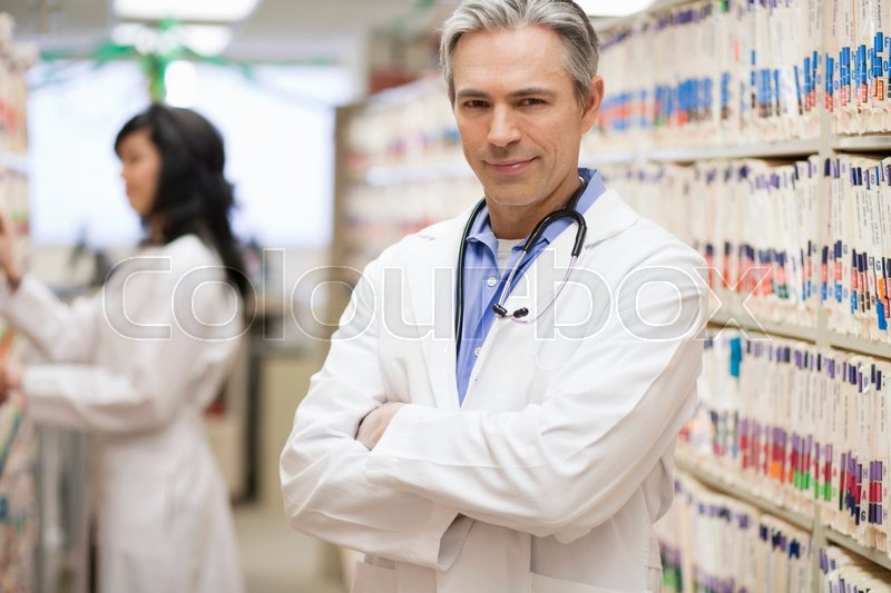 Male Doctor smiling with female doctor, stock photo