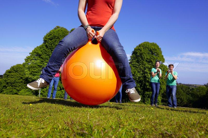 Teams racing on exercises balls, stock photo